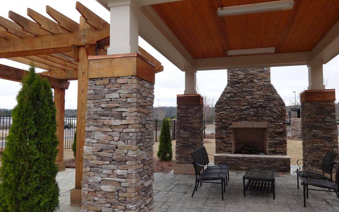 outdoor fireplace with stone veneer